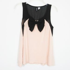 Divided sheer sleeveless bow top size XS